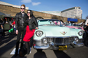 The Classic Car Boot Sale at the Southbank Centre, South Bank, London, UK. Vintage cars, fashion and style assemble together to celebrate all things classic from the 1940s to 1960s. People hanging around and having their pictures taken by beautiful classic American cars.