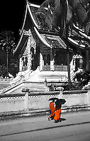 Monks passing by Haw Pha Bang pavillion houses the most important buddhist relic in Laos.