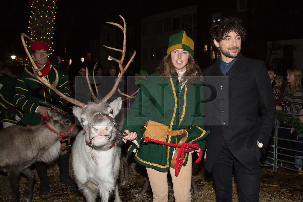 © Licensed to London News Pictures. 17/11/2012. London, England. Alex Zane with Hander and reindeer. Radio, TV presenter, comedian and DJ Alex Zane switches on the Christmas lights in Highgate Village, North London. Photo credit: Bettina Strenske/LNP