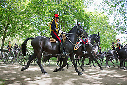 © Licensed to London News Pictures. 03/06/2013. London, UK. Gunners of the King's Troop Royal Horse Artillery, the ceremonial saluting battery of the Household Division,  fire a 41 gun ceremonial salute in Green Park London today (03/06/2013) in honour of the 60th Anniversary of the Coronation of Her Majesty The Queen. Photo credit: Matt Cetti-Roberts/LNP