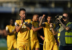 Sutton United's Richie Bennett applauds the home fans after the Sky Bet League Two match at Borough Sports Ground, Sutton. Picture date: Saturday October 9, 2021.