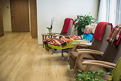 Senior man sleeping in relaxation area at rest home