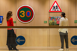 "© Licensed to London News Pictures. 20/10/2020. LONDON, UK.  London, UK.  20 October 2020. Staff members view ""30"", 2019, and ""Mouse Crossing"", 2019, by Margaret Calvert.  Preview of Margaret Calvert: Woman at Work at the Design Museum in Kensington.  The exhibition explores the graphic designer's influence on the UK's visual identity and continuing impact through projects such as the new Rail Alphabet 2 typeface for Network Rail.  Photo credit: Stephen Chung/LNP"