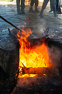 A pot containing the guava-sugar mixture simmers over open flames during the process of making Guyaba bars (Florida, Camagüay Province, Cuba).