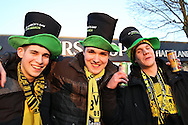 a Group of Borussia Dortmund fans posing outside White Hart Lane Stadium before k/o wearing St.Patrick Day top hats. UEFA Europa League round of 16, 2nd leg match, Tottenham Hotspur v Borussia Dortmund at White Hart Lane in London on Thursday 17th March 2016<br /> pic by John Patrick Fletcher, Andrew Orchard sports photography.
