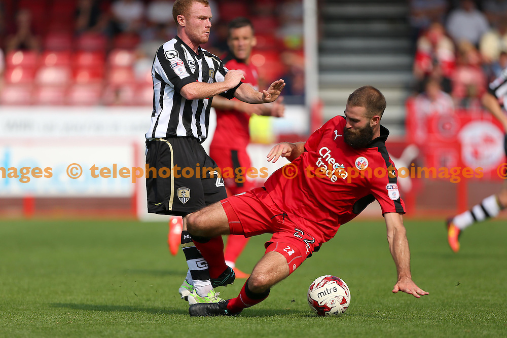 Crawley's Joe McNerney  slides into tackle Adam Campbell of Notts County during the Sky Bet League 2 match between Crawley Town and Notts County at the Checkatrade Stadium in Crawley. August 27, 2016.<br /> James Boardman / Telephoto Images<br /> +44 7967 642437