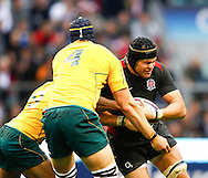 Tom Palmer of England is tackled by Mark Chisholm (4) and Ben McCalman (8) of Australia during the Investec series international between England and Australia at Twickenham, London, on Saturday 13th November 2010. (Photo by Andrew Tobin/SLIK images)