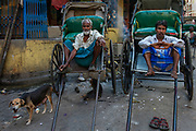 Rickshaw wallahs waiting for business at the Hogg Market (New Market), Sudder Street shopping area of Calcutta (Kolkata).