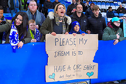 Fans hold a sign in the stands asking for a shirt ahead of the Emirates FA Cup, Third Round Replay at Stamford Bridge, London.