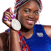 14 August 2012:  Olympic Silver Medalist Isabelle Yacoubou (Team France Basketball) poses with her silver medal, at the Hotel Concorde Lafayette, in Paris, France.