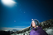 Rylan Bowers smiles at the moon on a night hike above Francie's Hut in the Tenmile Range, Arapaho National Forest, Colorado.