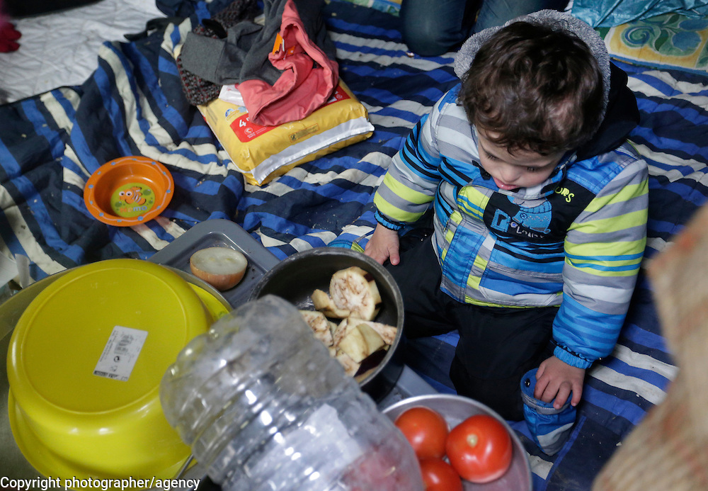 Lawey (4) plays, 22 January, in his tent in Grande Synthe. refugee camp near Dunkirk<br /><br />Lawey has downs-syndrome and has the family have been receiving medical help and support from MSF who operate a clinic in the camp.<br />Lawey's mother, Hero, was separated from her husband in Turkey and is alone in carring for her 4 year old son and his 14-year-old sister as they attempt to claim asylum in the United Kingdom.