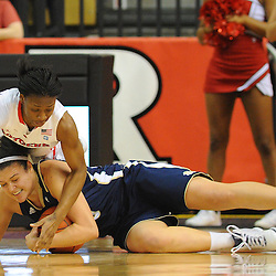 Notre Dame Fighting Irish guard Kayla McBride (23) and Rutgers Scarlet Knights guard Erica Wheeler (3) dive for a loose ball during first half NCAA Big East women's basketball action between Notre Dame and Rutgers at the Louis Brown Athletic Center. Notre Dame leads 40-23 at halftime.