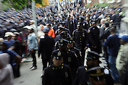 Atmosphere at the funeral for NYPD Officer Omar Edwards held at Our Lady of Victory in Brooklyn on June 4, 2009..NYPD Officer Omar Edwards posthumusly promoted to the rank of Detective was killed by NYPD Detective Andrew Dunton in a case of friendly fire, when Edwards was takened for a suspect with gun in hand. On Thursday June 4 2009, Officer Omar J. Edwards, 25, was shot by a fellow officer on a Harlem street while in street clothes. He had just finished his shift, and had his service weapon out, chasing a man who had broken into his car, police said. Three plainclothes officers on routine patrol arrived at the scene and yelled for the two to stop, police said. One officer, Andrew Dunton, opened fire and hit Edwards three times as he turned toward them with his service weapon. It wasn't until medical workers were on scene that it was determined he was a police officer.