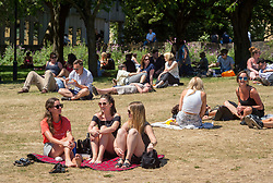 © Licensed to London News Pictures.  27/06/2018; Bristol, UK. People enjoy the sunshine during the lunch break in Castle Park in the city centre of Bristol. Photo credit: Simon Chapman/LNP