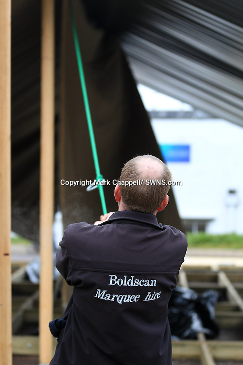 One of Albion Canvas' luxury tented lodges being assembled. Albion is part of Boldscan Marquee Hire Ltd.  Wellington, Somerset , UNITED KINGDOM. March 02 2012.