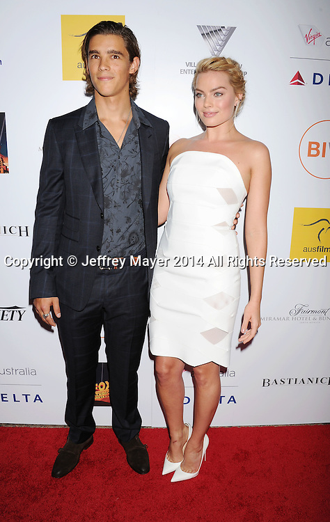 SANTA MONICA, CA- OCTOBER 26: Actors Brenton Thwaites (L) and Margot Robbie attend the 3rd Annual Australians in Film Awards Benefit Gala at the Fairmont Miramar Hotel on October 26, 2014 in Santa Monica, California.