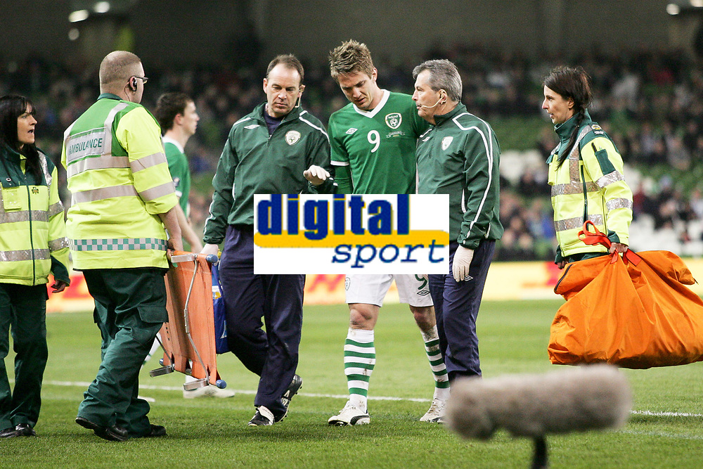 Football - UEFA Championship Qualifier - Republic of Ireland v FYR Macedonia<br /> Kevin Doyle  (Rep of Ireland) is led from the field after being injured in the UEFA Championship Group B Qualifier between the Republic of Ireland and FYR Macedonia at the Aviva Stadium in Dublin.