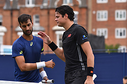 June 19, 2018 - London, England, United Kingdom - Milos Raonic (R) of Canada wins against Yuki Bhambri (IND) in the first singles match on day two of Fever Tree Championships at Queen's Club, London on June 19, 2018. (Credit Image: © Alberto Pezzali/NurPhoto via ZUMA Press)