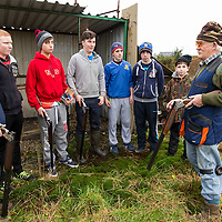 Noel O'Donohue coaching a group of young men at the Kilfenora shoot