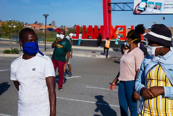 May 2, 2020 - Johannesburg, Gauteng, South Africa - People stand in the queue and maintaining social distance at Alex mall. (Credit Image: © Manash Das/ZUMA Wire/ZUMAPRESS.com)