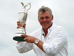 File photo dated 18-07-2011 of Northern Ireland's Darren Clarke celebrates with the Claret Jug.