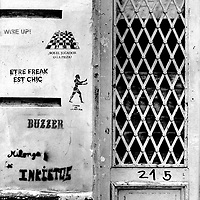 """Translation: (above) """"ARE YOU THE PLAYER OR THE PIECE"""" (below) """"TO BE FREAK IS COOL""""<br /> <br /> Buenos Aires, Argentina March 2006<br /> Protest, resistance and memory:  The Stencil images in Buenos Aires. <br /> The stencil art takes the streets of the Argentinian capital. Urban artists bomb in silence the city with messages that combine political and social content, imagination and irony.<br /> Photo: Ezequiel Scagnetti"""