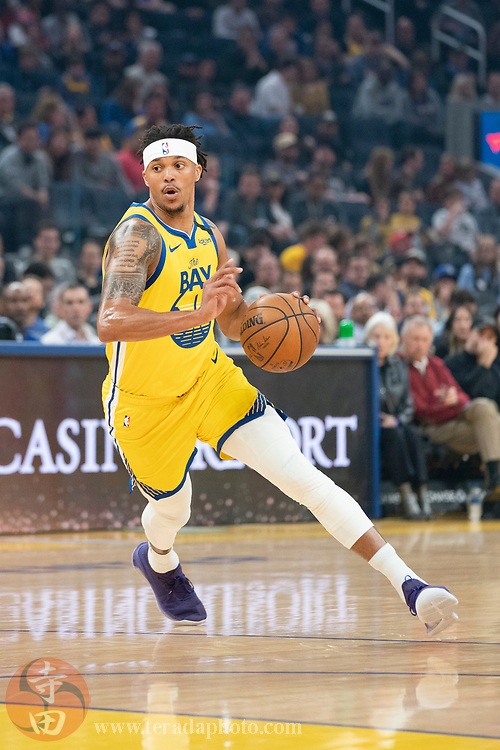 February 23, 2020; San Francisco, California, USA; Golden State Warriors guard Damion Lee (1) dribbles the basketball during the first quarter against the New Orleans Pelicans at Chase Center.