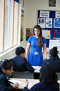 Teachers assistant in a history class at Pimlico Academy, a modern secondary school in London, UK. Students education here is based on aspiration and is a huge success story following a large scale conversion.