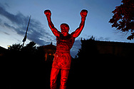 The Rocky Statue near the steps leading up to the entrance of the Philadelphia Museum of Art is lit by red light Sept. 1, 2020, in Philadelphia, Pennsylvania, signifying the 'Red Alert' workers in the live events industry are facing due to the impact of the COVID-19 pandemic. This nationwide effort, organized by the Live Events Coalition, is also a push for Congress towards continuation and extension of the Pandemic Unemployment Assistance to provide relief to those without work due to COVID-19.