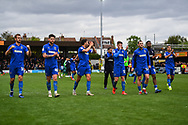 Wimbledon players celebrate with the fans after their victory during the EFL Sky Bet League 1 match between AFC Wimbledon and Wycombe Wanderers at the Cherry Red Records Stadium, Kingston, England on 27 April 2019.