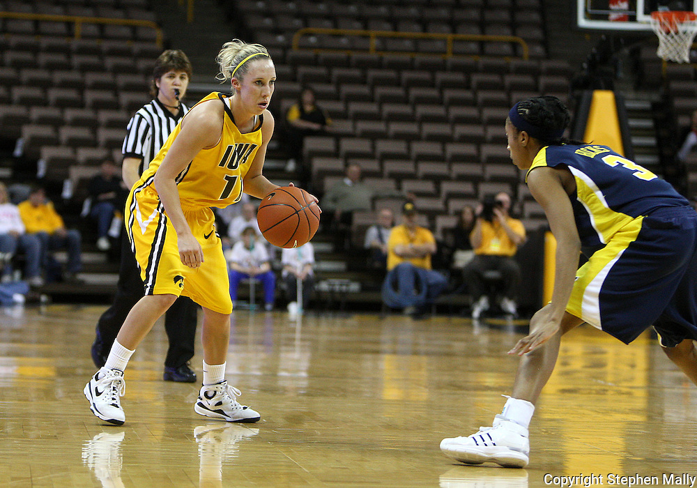 26 JANUARY 2009: Iowa guard Kristi Smith (11) is defended by Michigan guard Veronica Hicks (3) during the first half of an NCAA women's college basketball game Monday, Jan. 26, 2009, at Carver-Hawkeye Arena in Iowa City, Iowa. Iowa defeated Michigan 77-69.
