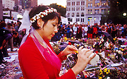 NEW YORK, NY: A woman lights candles at a memorial  in Union Square for people killed in the WTC attacks in New York City, Sept 18, 2001. Almost 3,000 people were killed when terrorists, affiliated with Osama bin Laden, hijacked and crashed two passenger jets into the twin towers on the southern tip of Manhattan. Thousands of memorials for the dead and missing have been built in lower Manhattan, many of them in Union Square. PHOTO BY JACK KURTZ
