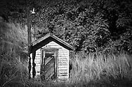 "pump house that somone had labeled ""Jail"" as a joke at the Almota Docks on the Snake River, La Crosse, WA"