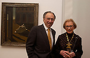 Robert and Maurine Rothschild, ( in front of the  the 1912 painting they loaned to the exhibition) Giorgio de Chirico and the Myth of Ariadne, Estorick Collection, London. 21 January 2003. © Copyright Photograph by Dafydd Jones 66 Stockwell Park Rd. London SW9 0DA Tel 020 7733 0108 www.dafjones.com