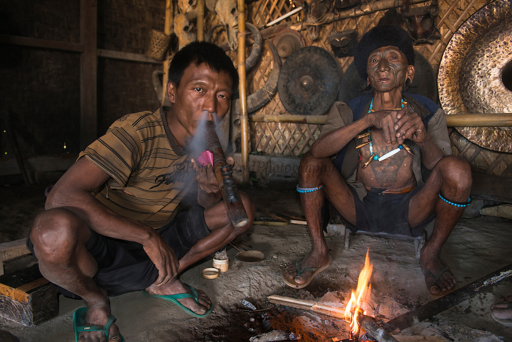 Konyak Naga opium smokers<br /> Konyak Naga headhunting Tribe<br /> Mon district<br /> Nagaland,  ne India