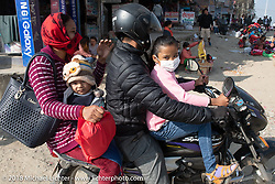 A family outing on the family bike in Kathmandu after our Himalayan Heroes motorcycling adventure, Nepal. Saturday, November 17, 2018. Photography ©2018 Michael Lichter.