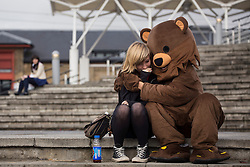 © licensed to London News Pictures. London, UK 28/10/2012. A cosplayer dressed as a teddy bear hugging his girlfriend outside ExCeL, London as people visit MCM Expo. Photo credit: Tolga Akmen/LNP
