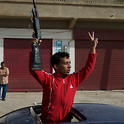A young Libyan protests against Gaddafi's regime, during a demonstration in favor of a free Libya in central Ajdabiya.