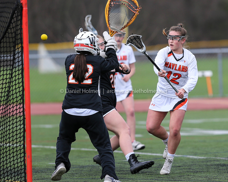 (4/30/18, WAYLAND, MA) Wayland's Kate Balicki shoots and scores during the girls lacrosse game against Woburn at Wayland High School on Monday. [Daily News and Wicked Local Photo/Dan Holmes]