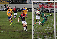 Bolton Wanderers Declan John scores his side's first goal   beating Mansfield Town's Aidan Stone<br /> <br /> Photographer Mick Walker/CameraSport<br /> <br /> The EFL League 2 - Mansfield Town v Bolton Wanderers  - Wednesday 17th February  2021 - One Call Stadium-Mansfield<br /> <br /> World Copyright © 2020 CameraSport. All rights reserved. 43 Linden Ave. Countesthorpe. Leicester. England. LE8 5PG - Tel: +44 (0) 116 277 4147 - admin@camerasport.com - www.camerasport.com