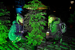 """© Licensed to London News Pictures. 06/01/2014; Bristol, UK.  Becky Hall and Vicky Jones, both from Bristol, at the Launch of Second Chance, a temporary forest of Christmas trees collected by MAYK, in collaboration with Bristol City Council, from Bristol residents and given a new lease of life as part of a temporary forest on Waterfront Square at Bristol's harbourside.  """"Second Chance, Created by artists Michaela Klakurková and Jan ?aloudek under curatorship of Marcela Straková in co-production the New Stage of the Czech Republic National Theatre, is a powerful, gentle and simple gesture, making something beautiful out of something that ordinarily gets discarded without care.""""  The project was launched on Monday 6 January with a performance by the appropriately named Czech band Please The Trees.  Ffi:  http://www.mayk.org.uk/portfolio/second-chance/      06 January 2014.<br /> Photo credit: Simon Chapman/LNP"""