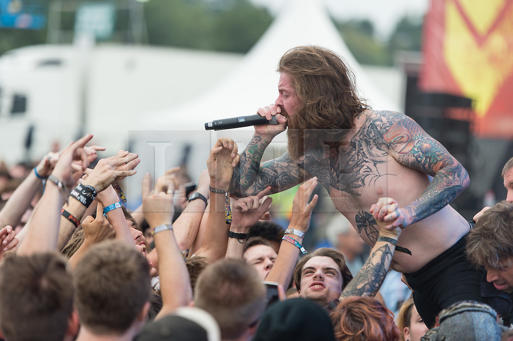 © Licensed to London News Pictures. 30/08/2015. Reading, UK. Feed the Rhino performing at Reading Festival 2015, Day 3 Sunday.  In this picture - Lee Tobin.  Photo credit: Richard Isaac/LNP