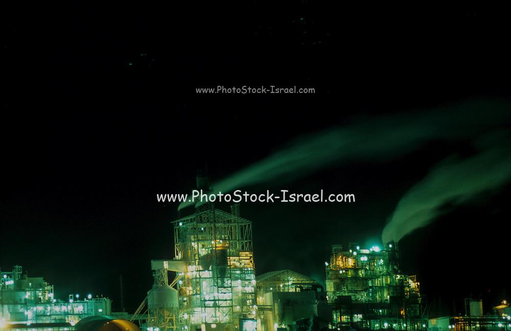 air pollution- smoking chimneys at night, at the phosphate factory, negev, israel