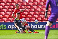 Daniel Pinillos of Barnsley (23) is tacked by Ryan Sears of Shrewsbury Town (27) during the EFL Sky Bet League 1 match between Barnsley and Shrewsbury Town at Oakwell, Barnsley, England on 19 April 2019.