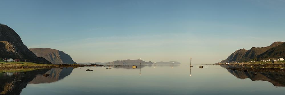 Søre Vaulen, Nearby Fosnavåg, Norway in beutiful morning light   Tidlig morgenlys i Søre Vaulen ved Fosnavåg, med flatt hav og spegling i sjøen