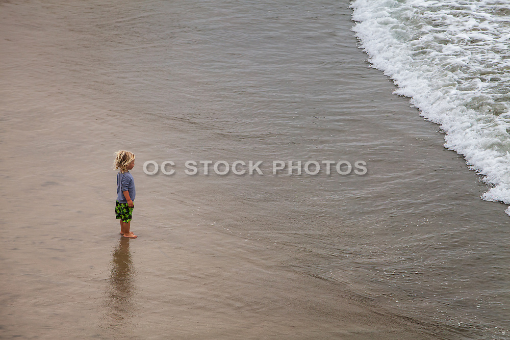 Young Boy On The Beach At Low Tide In Orange County California