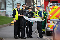 © Licensed to London News Pictures . 18/04/2018. Manchester, UK. Buildings are evacuated and streets closed off by police amid reports of a chemical spill at a building belonging to the Manchester Institute of Biotechnology on Princess Street in Manchester City Centre . Photo credit : Joel Goodman/LNP