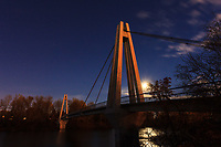 An almost full moon rises behind the pedestrian bridge between Riverbend and Sue Higgins Park (Southland Dog Park). The Moon came up just as the sun went down which allowed the <br /> <br /> ©2013, Sean Phillips<br /> http://www.RiverwoodPhotography.com