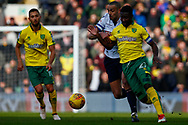 Norwich City midfielder Alexander Tettey (27) Bolton Wanderers midfielder, Darren Pratley (21) battles for possession during the EFL Sky Bet Championship match between Norwich City and Bolton Wanderers at Carrow Road, Norwich, England on 24 February 2018. Picture by Phil Chaplin.